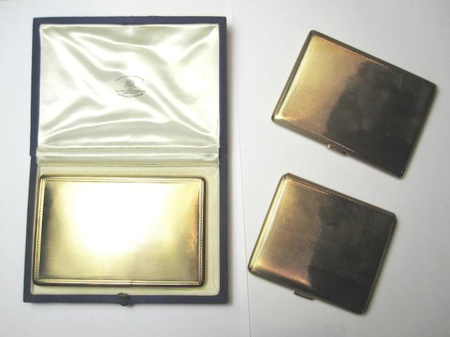 Three gold cigarette cases