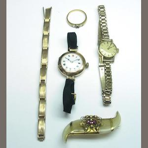 A tiger's claw brooch, a lady's 9ct gold Omega wristwatch, a 9ct lady's wristwatch, and a diamond ring (one stone deficient).