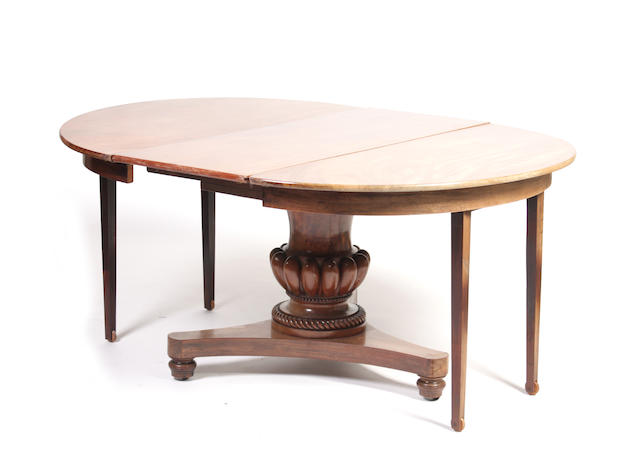 An early Victorian and later mahogany extending dining table