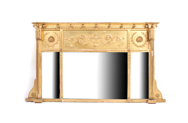 A George IV carved giltwood and gesso overmantel mirror