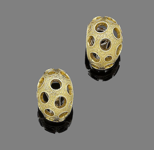 A pair of earclips, by Kutchinsky,