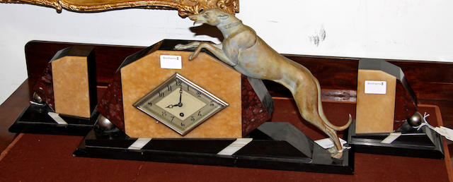 An Art Deco slate, spelter and marble figural mantle clock,