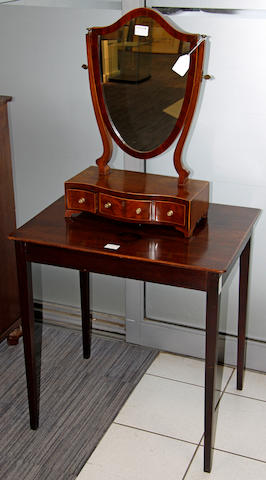 A George III mahogany side table,on square tapering legs, 66 x 49cm and a mahogany shield shaped swing toilet mirror on serpentine three drawer base, 41cm wide (2)