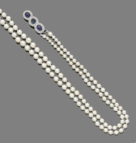 A two-row pearl necklace with sapphire and diamond clasp