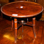 A mahogany adjustable occasional table 19th Century