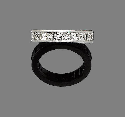 A diamond eternity ring, by Theo Fennell