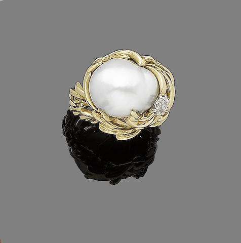 A cultured pearl and diamond ring, by Gilbert Albert