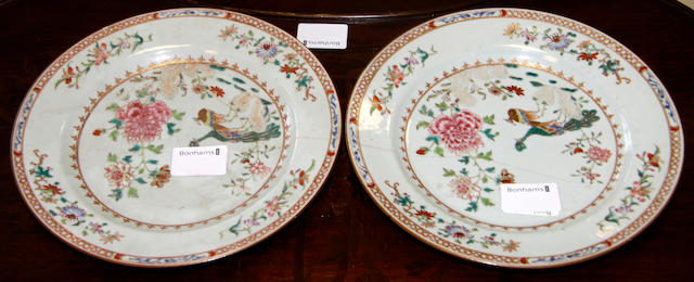 A pair of Chinese double peacock famille rose plates,