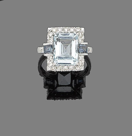 An aquamarine, sapphire and diamond dress ring
