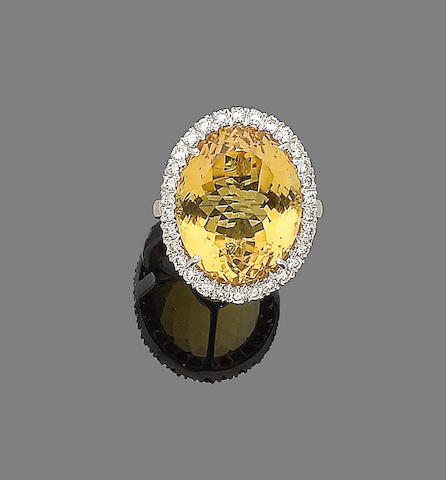 A citrine and diamond cluster ring