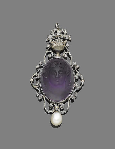 A carved amethyst and natural pearl pendant