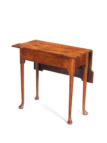 An 18th century yew wood drop leaf table