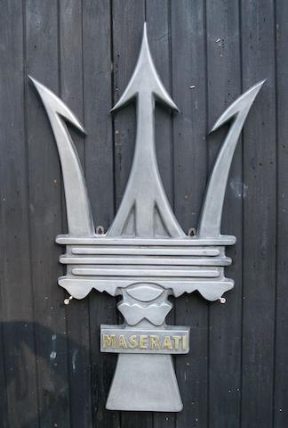 A 'Maserati' Trident garage display emblem,