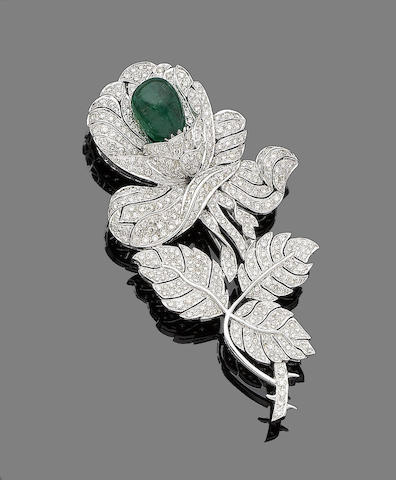 An emerald and diamond flower brooch
