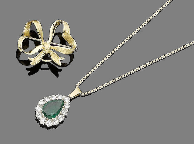 An emerald and diamond pendant necklace and a bow brooch (2)