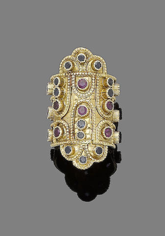 A 'Chrysotectonemata' sapphire and ruby ring,  by Lalaounis