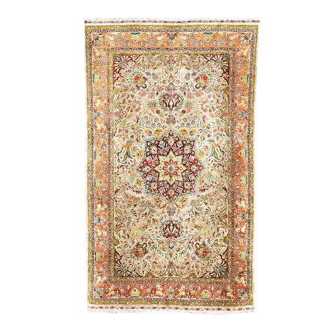 A silk Tabriz carpet, North West Persia, 283cm x 172cm