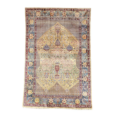 A silk Kashan carpet, Central Persia, 310cm x 211cm