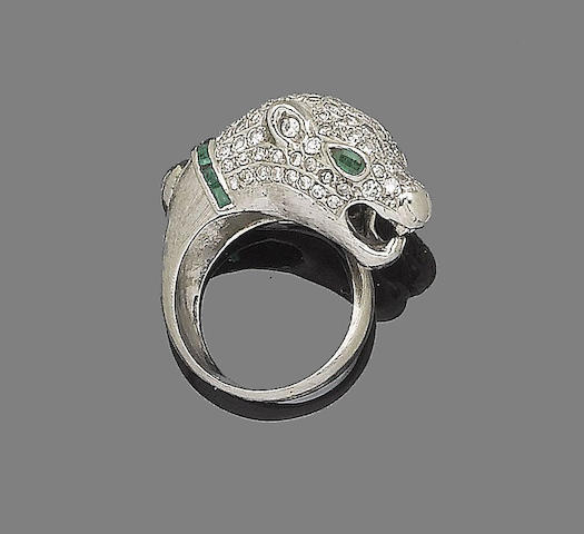 An emerald and diamond cougar ring