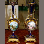 A pair of continental porcelain gilt-metal mounted vases