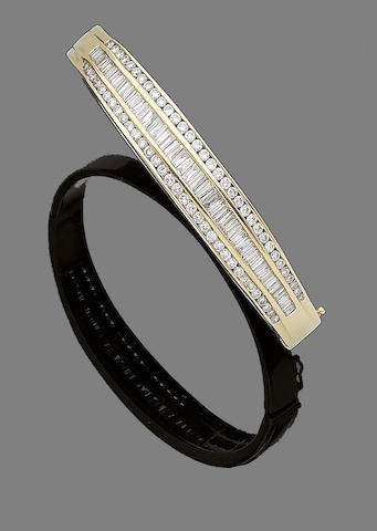 A diamond hinged bangle