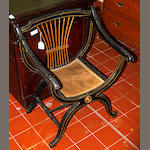 A Regency style ebonised x-frame armchair