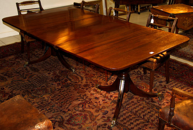 A  mahogany twin pillar dining table,
