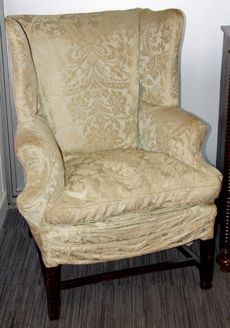 A George III mahogany wing back armchair