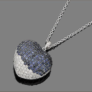 A sapphire and diamond heart pendant necklace