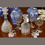Two cut glass decanters,one with cylindrical body, the other pear-shaped, a pair of cream jugs each with a band of hobnail cut decoration, a large goblet with faceted bucket shaped bowl and two other goblets