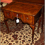 A George II walnut lowboy,
