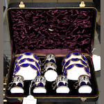 An Edwardian cased set of six Coalport silver mounted coffee cans and saucers