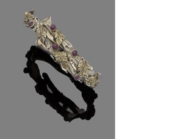 A ruby-set bangle, by Buccellati