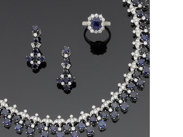 A sapphire and diamond collar necklace, earrings and ring (3)