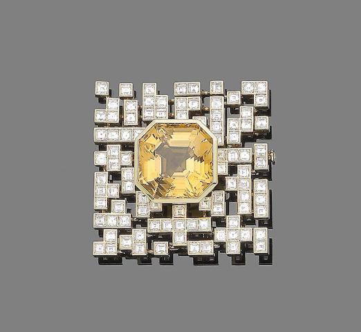 A topaz and diamond brooch