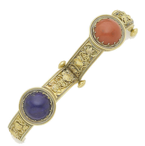 A mid 19th century gold, coral and lapis lazuli hinged bangle