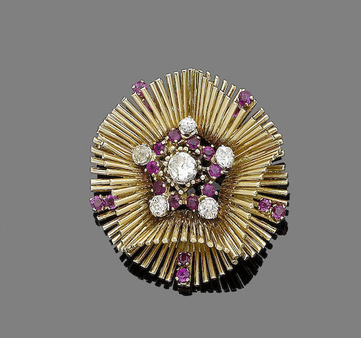 A gold, ruby and diamond brooch, by Sannit & Stein,