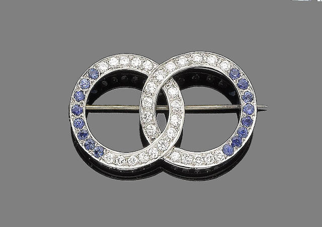 A sapphire, synthetic sapphire and diamond brooch