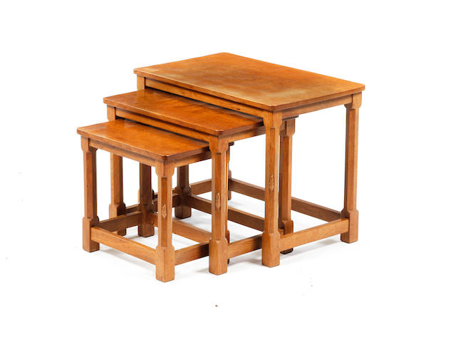 A nest of three Robert 'Mouseman' Thompson oak tables