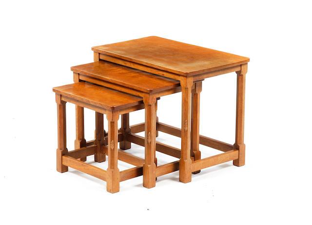 A nest of three Robert 'Mouseman' Thompson oak tables