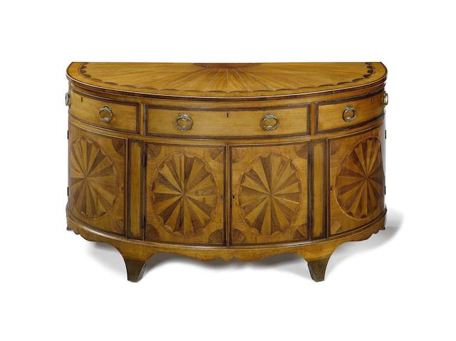 A George III mahogany, purplewood and rosewood crossbanded demi-lune commode attributed to Gillows