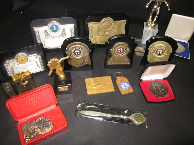 A collection of trophies and medals awarded to Dick Spence