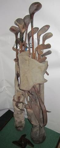 Two golf bags containing a selection of wooden shafted golf clubs various makes and conditions