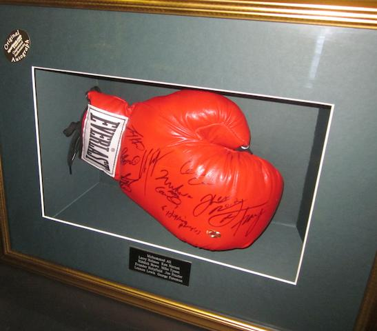 Heavyweight Champions of the World hand signed boxing glove including Muhammad Ali and Joe Frazier