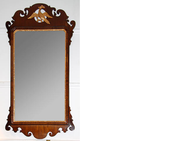 An 18th Century style mahogany and parcel gilt, fret carved mirror,