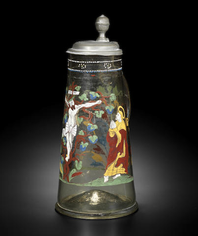 A rare Bohemian enamelled tankard with pewter mount, painted with the Crucifixion, late 16th century
