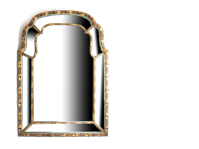 A Georgian style gilt and painted pier mirror