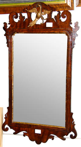A George II walnut fretcut wall mirror mid 18th Century