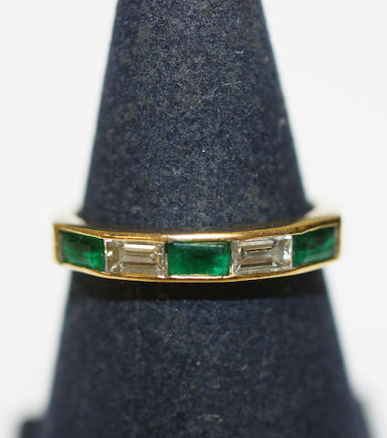 An 18ct gold emerald and diamond ring,