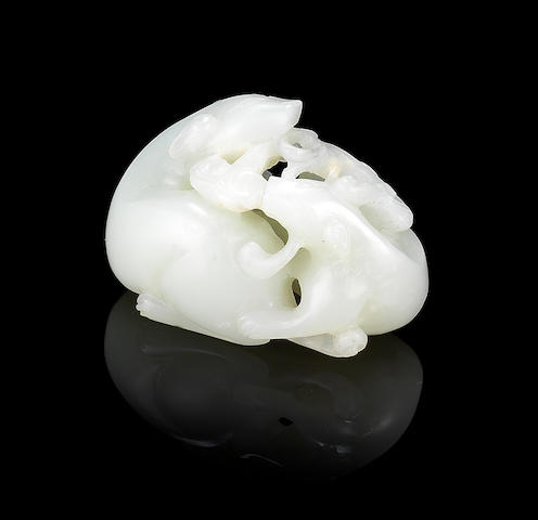 A reticulated jade carving of two badgers